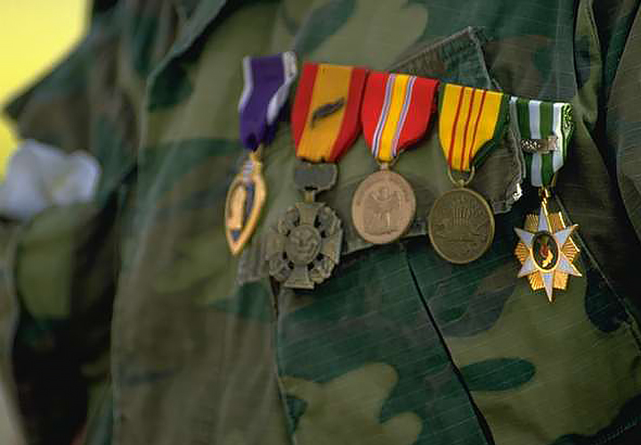 The breast of a military uniform, adorned with several medals